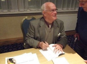 "Jimmy Halliday signing a copy of his book ""Yours for Scotland"" for Paul Scott at the  Scots Independent fringe meeting at the SNP Conference in Inverness in October 2011. Photo Tony Grahame"